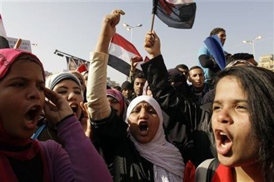 ** FILE ** Egyptian girls chant slogans in Tahrir Square during a rally to mark the one year anniversary of the uprising that ousted President Hosni Mubarak in Cairo, Egypt, Jan 25, 2012. Egyptian women are growing increasingly angry as they deal with an epidemic of sexual assault. (Associated Press)