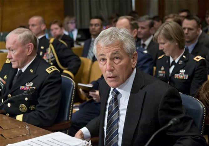 Defense Secretary Chuck Hagel, center, flanked by Joint Chiefs Chairman Gen. Martin Dempsey, left, and Pentagon Comptroller Robert Hale, listens on Capitol Hill in Washington, Tuesday, June 11, 2013, during the Senate Defense subcommittee hearing on department leadership. (Associated Press)