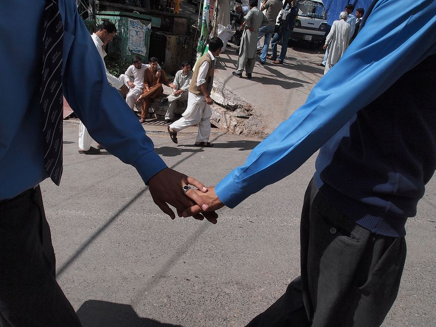 After school, boys head home in Murree. These two brothers hold hands, expressing friendship and bonding. Photo / Faryal Mohmand