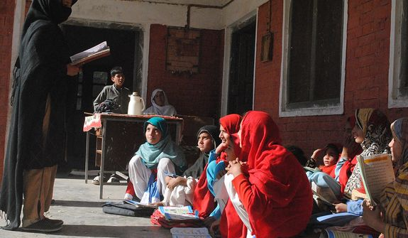 In Mohmand Agency, a teacher reads the lesson to her students. The government-run girl's primary school does not exist anymore, as it was destroyed in a bomb attack by the militants who oppose education for girls. Now these girls come to our house and my mother teaches them at home. Photo / Hina Gul Mohmand