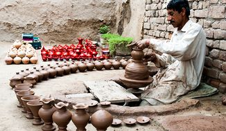 Baseer runs a pottery workshop in Jamrud, Khyber Agency, in FATA. He works on a machine pedaled by his feet. Some of his pots are used for drinking water; others are for kids to collect coins called khazana, treasure, in the local language. To get the money out, the children have to break to pot. Photo / Muhammad Khalid Afridi
