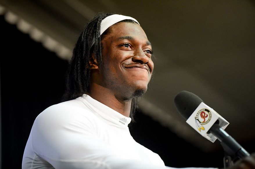 Washington Redskins quarterback Robert Griffin III (10) attends a press conference after practice during mini camp at Redskins Park, Ashburn, Md., Tuesday, June 11, 2013. (Andrew Harnik/The Washington Times)