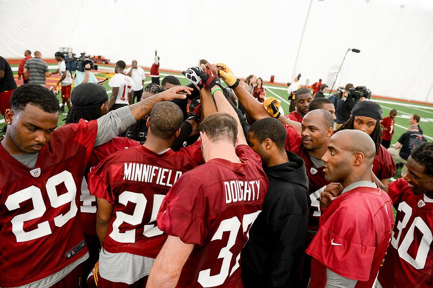 Defensive backs huddle up together at the conclusion of practice during mini camp at Redskins Park, Ashburn, Md., Tuesday, June 11, 2013. (Andrew Harnik/The Washington Times)
