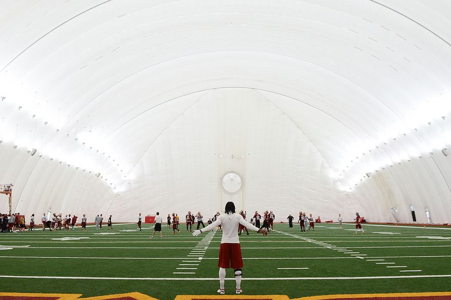 Washington Redskins quarterback Robert Griffin III (10) stands in the end zone at the end of practice during mini camp at Redskins Park, Ashburn, Md., Tuesday, June 11, 2013. (Andrew Harnik/The Washington Times)