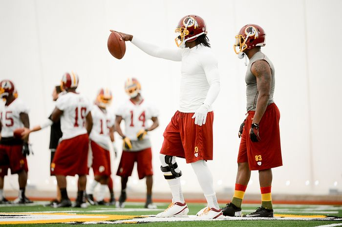 Washington Redskins quarterback Robert Griffin III (10) and tight end Fred Davis (83), right, run plays together during mini camp at Redskins Park, Ashburn, Md., Tuesday, June 11, 2013. (Andrew Harnik/The Washington Times)