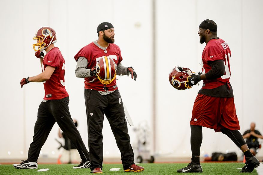 Washington Redskins inside linebacker Perry Riley (56), center, and outside linebacker Brian Orakpo (98), right, share a laugh during mini camp at Redskins Park, Ashburn, Md., Tuesday, June 11, 2013. (Andrew Harnik/The Washington Times)