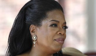 Oprah Winfrey, pictured after delivering the commencement address at Harvard University in Cambridge, Mass., on Thursday, May 30, 2013, is giving $12 million to a museum being built on the National Mall in Washington that will document black life. (AP Photo/Elise Amendola)