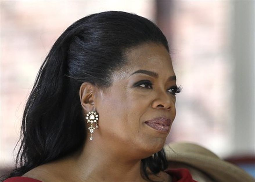 Oprah Winfrey, shown following her commencement address at Harvard University last month, is giving $12 million to a museum being built on the National Mall that will document African-American life. (AP Photo/Elise Amendola, File)