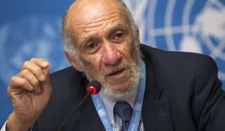 Richard A. Falk, an American who is U.N. special rapporteur on human rights in the Palestinian territories, answers journalists' questions during a press conference after he presented his report to the U.N. Human Rights Council at the European headquarters of the United Nations in Geneva on Tuesday, June 11, 2013. (AP Photo/Keystone, Salvatore Di Nolfi)