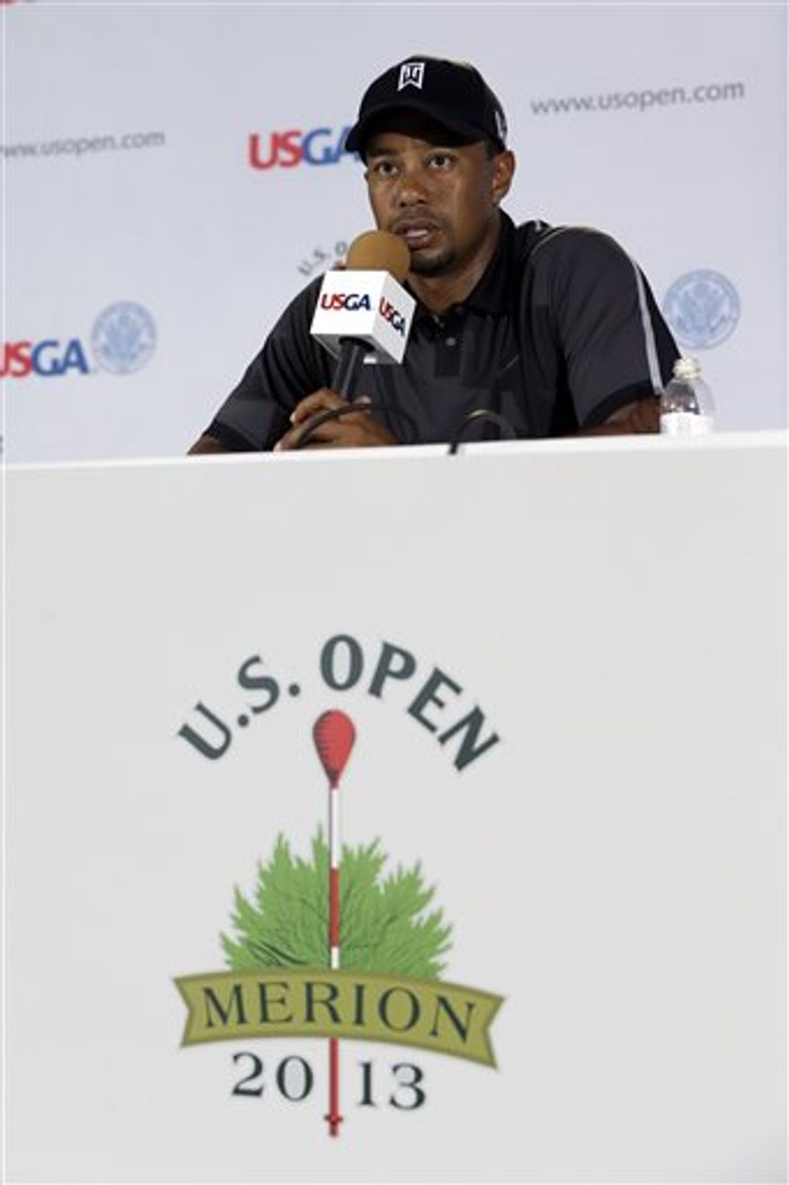 Tiger Woods speaks during a news conference at the U.S. Open golf tournament at Merion Golf Club, Tuesday, June 11, 2013, in Ardmore, Pa. (AP Photo/Gene J. Puskar)