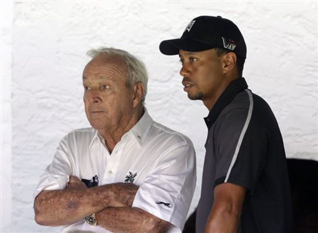 Arnold Palmer, left, and Tiger Woods watch as golfers tee off on the first hole during practice for the U.S. Open golf tournament at Merion Golf Club, Tuesday, June 11, 2013, in Ardmore, Pa. (AP Photo/Gene J. Puskar)
