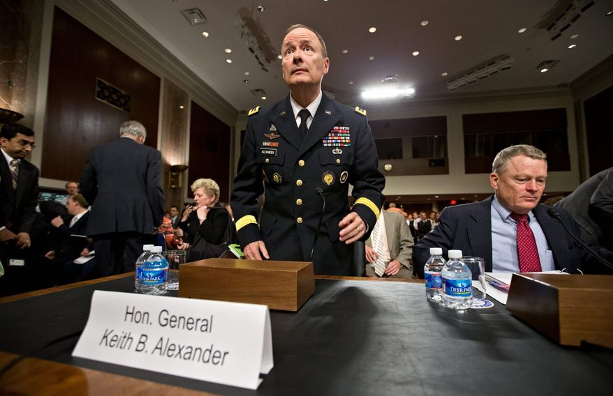 Gen. Keith B. Alexander, director of the National Security Agency and head of the U.S. Cyber Command, said on Wednesday he would discuss specific foiled terrorist plots in more detail Thursday during a closed congressional hearing on the NSA leak. (Associated Press)