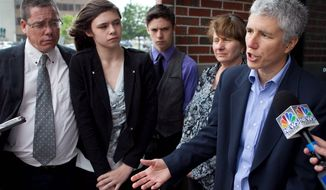 Jennifer Levi, attorney for transgender student Nicole Maines, second from left, speaks to reporters outside the Penobscot Judicial Center, Wednesday, June 12, 2013, in Bangor, Maine. The state supreme court heard arguments on Wednesday over a school districtís handling of Nicole Maine's restroom needs. Also pictures are Nicole's father Wayne Maine, left, twin brother Jonas Maines, center, and mother Kelly Maines.(AP Photo/Robert F. Bukaty)
