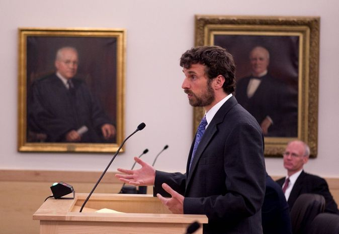 David Kallam, attorney for the school district being sued by the Maines family and the Maine Human Rights Commision, speaks before the Maine Supreme Court at the Penobscot Judicial Center, Wednesday, June 12, 2013, in Bangor, Maine. The lawsuit accuses the school district of breaking a state law in 2007 when it stopped letting the transgender student Nicole Maines use the girls bathroom and required to her use a staff bathroom after a student's grandfather complained. (AP Photo/Robert F. Bukaty, pool)