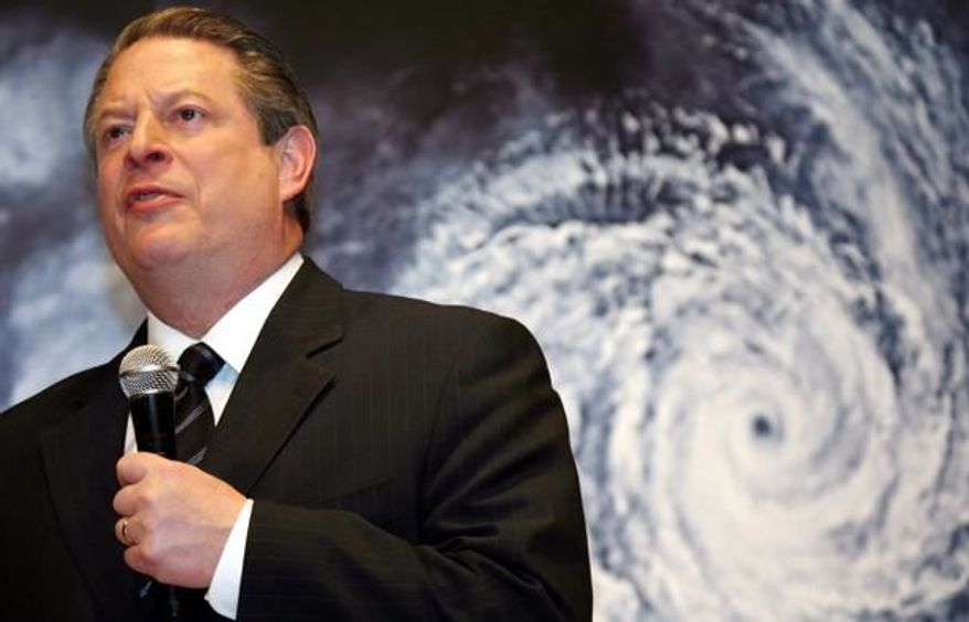 """** FILE ** Former U.S. Vice President Al Gore speaks in front of a poster for his documentary film on global warming, """"An Inconvenient Truth,"""" during the Japanese premier in Tokyo, In this Monday, Jan. 15, 2007 file photo. (Associated Press)"""