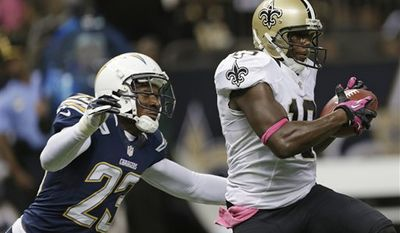 **FILE** New Orleans Saints wide receiver Devery Henderson (19) is pursued by San Diego Chargers cornerback Quentin Jammer (23) in the first half of an NFL football game at the Mercedes-Benz Superdome in New Orleans, Sunday, Oct. 7, 2012. (AP Photo/Dave Martin)