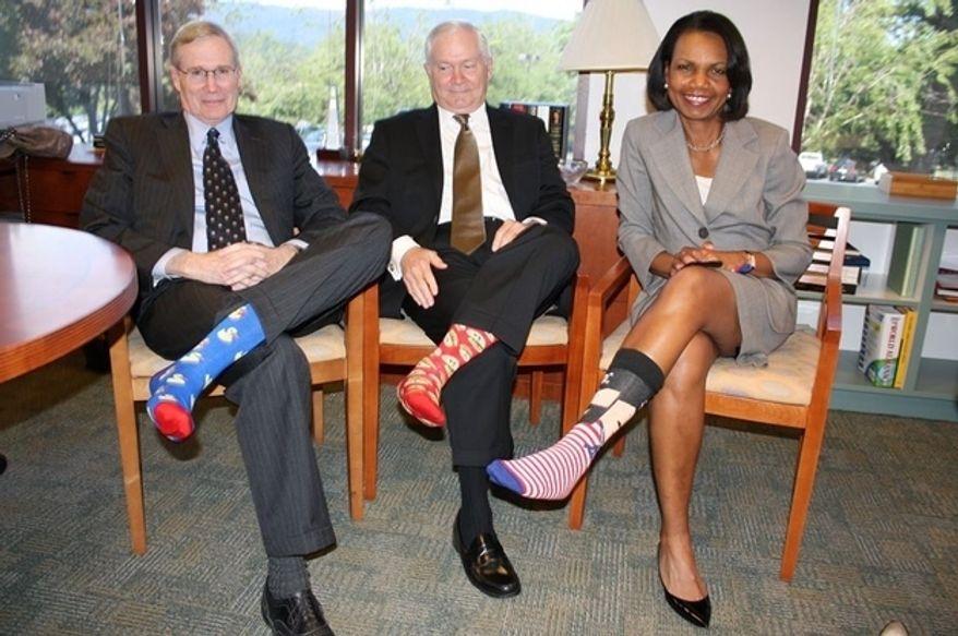 Stephen Hadley, Bob Gates and Condi Rice celebrate George H.W. Bush's birthday with these splashy socks.