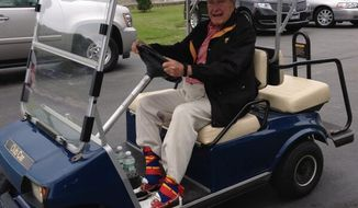 ** FILE ** George H.W. Bush wears Superman socks as part of his 89th birthday celebration in this photo released by his office.
