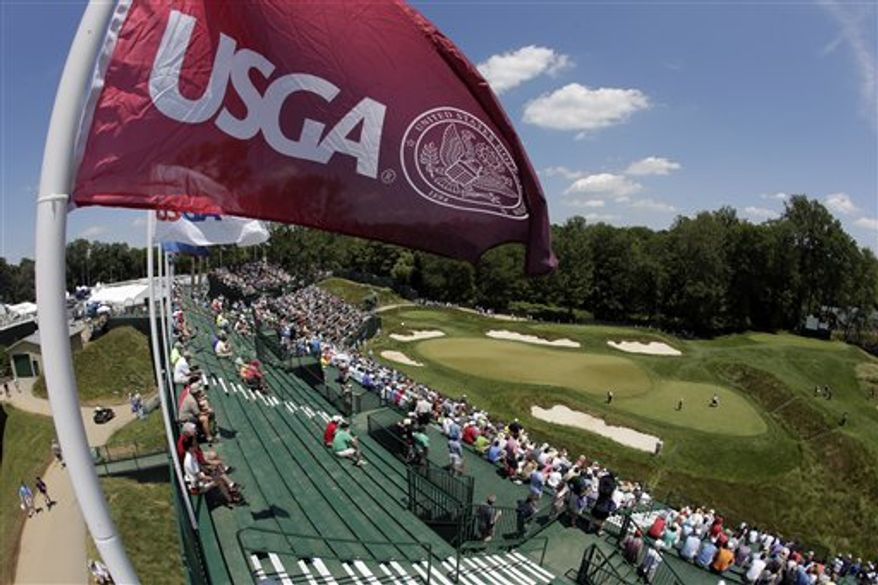 Spectators watch golfers on the 17th green during practice for the U.S. Open golf tournament at Merion Golf Club, Wednesday, June 12, 2013, in Ardmore, Pa. (AP Photo/Charlie Riedel)