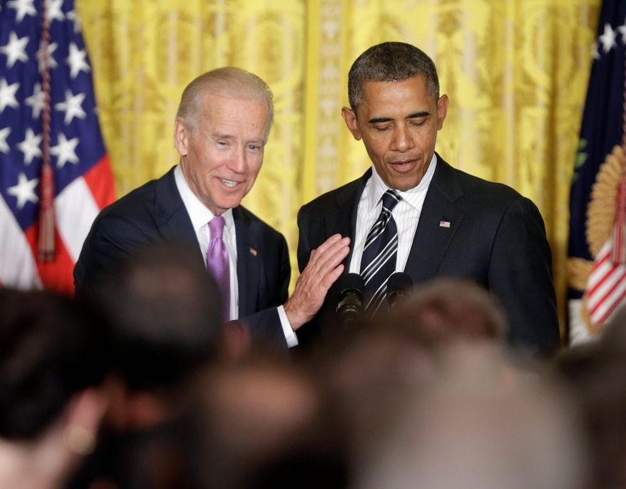 Vice President Joseph R. Biden pats President Obama on the chest Thursday while he speaks at a reception in the East Room of the White House to celebrate Lesbian, Gay, Bisexual and Transgender Pride Month. (Associated Press)