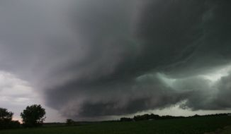 A wall cloud, containing a reported funnel cloud, passes over the Wanatah, Ind., area as a line of severe storm moves through the area Wednesday, June 12, 2013. (AP Photo/The LaPorte Herald-Argus, Bob Wellinski)
