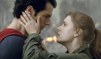 "Henry Cavill as Superman, left, and Amy Adams as Lois Lane in ""Man of Steel."" (AP Photo/Warner Bros. Pictures)"