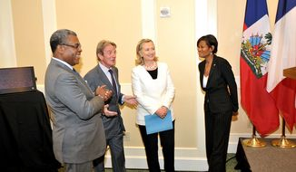 Secretary of State Hillary Clinton stands aside Cheryl Mills, her chief of staff. (credit: State Department photo)