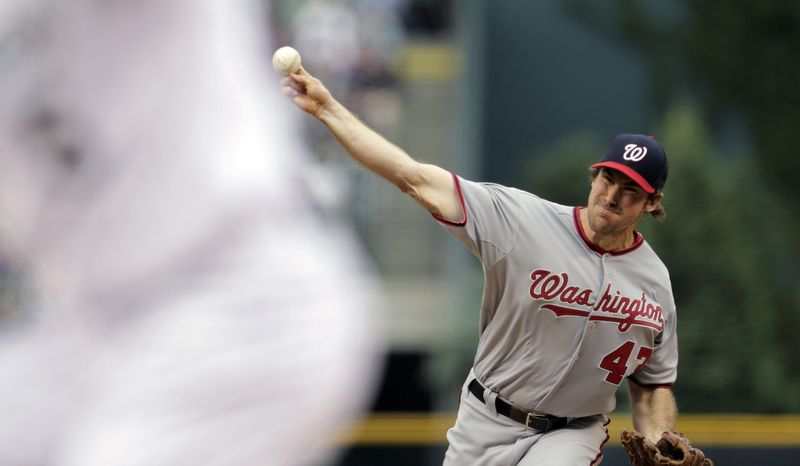 Ross Ohlendorf tossed six innings of one-run baseball against the Colorado Rockies on Wednesday night in the Washington Nationals' 5-1 victory. (Associated Press photo)