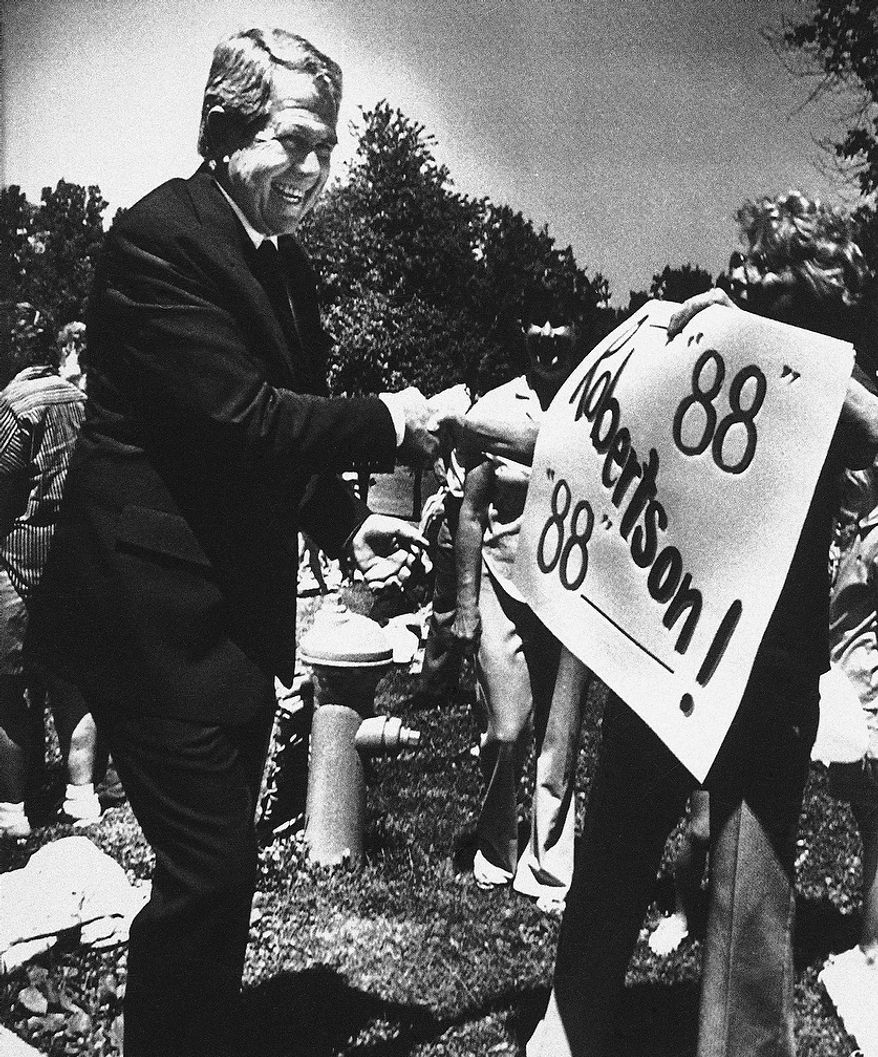 Republican presidential hopeful the Rev. Pat Robertson greets a supporter at a home schooling advocates' picnic in West Des Moines, Iowa, July 22, 1987. A political long shot, Robertson is trying to overcome some of the big names in the field with grassroots organizing. (AP Photo)