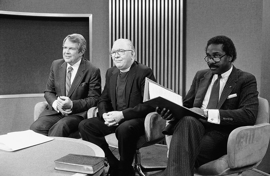 """Participants in a CBS """"Face the Nation"""" discussion on school prayer pose together before the show's telecast in Washington, March 5, 1984. From left are: Pat Robertson of Christian Broadcasting, the Rev. Charles Bergstrom of the Lutheran Council and actor Demond Wilson. (AP Photo)"""
