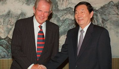 Pat Robertson, chairman of the Board of the Christian Broadcast Network, meets with Chinese Premier Zhu Rongji in Beijing, China, Wednesday, Aug. 26, 1998.(AP Photo/Xinhua)