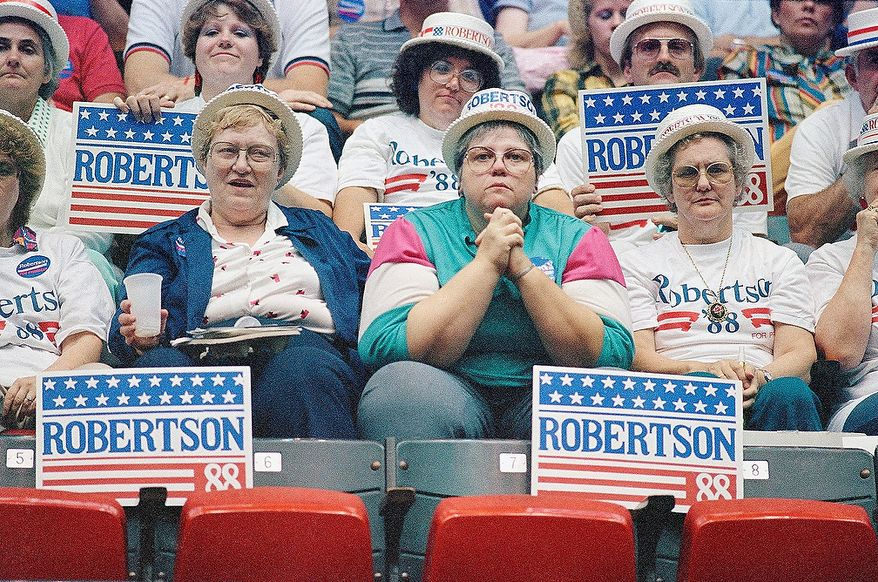 "Supporters for Republican presidential hopeful the Rev. Pat Robertson, occupying seats at Hilton Coliseum in Ames, Iowa, Saturday, Sept. 14, 1987 during the Republican Cavalcade of Stars. Robertson won a straw poll of those attending the GOP event, prompting Vice President George Bush to say Robertson, ""Came on like gangbusters."" (AP Photo/Jeff Davis)"