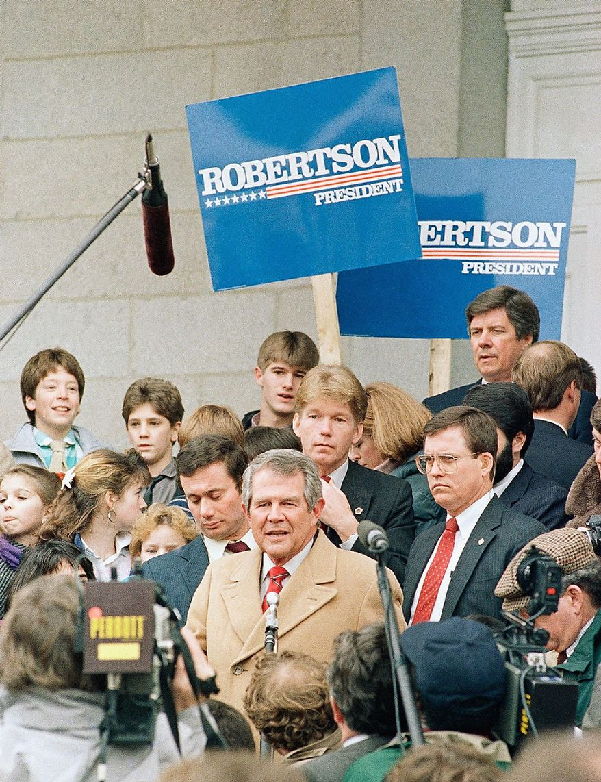 Republican presidential hopeful Pat Robinson meets with newsman outside the New Hampshire State House in Concord, New Hampshire, Thursday, Feb. 11, 1988 after he addressed a joint session of the legislature. The New Hampshire primary is scheduled for next week. (AP Photo/Herb Swanson)