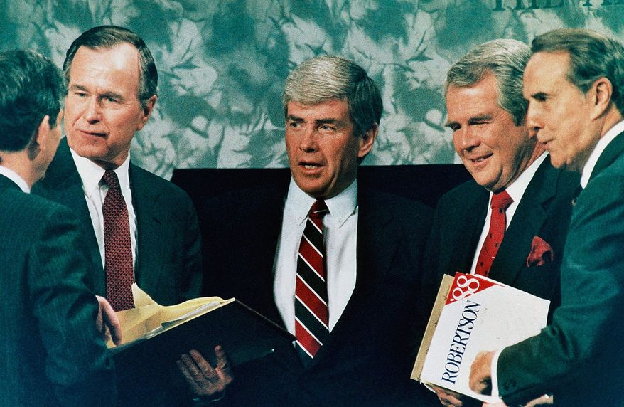 Republican presidential candidates from left to right are: President George Bush, Rep. Jack Kemp, R-NY, Pat Robertson, and Sen. Robert Dole talks with moderator John Mashek following the debate in Atlanta on Sunday, Feb. 28, 1988. (AP Photo)