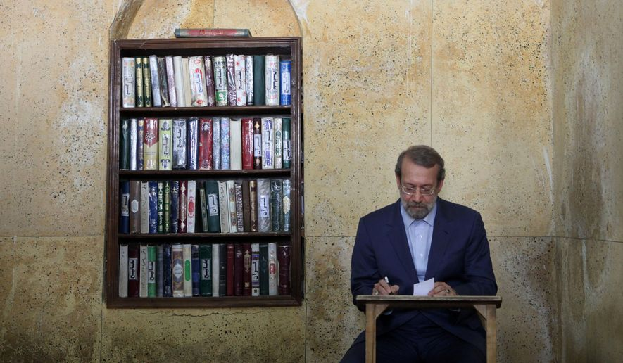 Iran's Parliament speaker Ali Larijani attends a polling station during presidential elections in Qom, 125 kilometers (78 miles) south of the capital Tehran, Iran, Friday, June 14, 2013. (AP Photo/Ebrahim Noroozi) ** FILE **