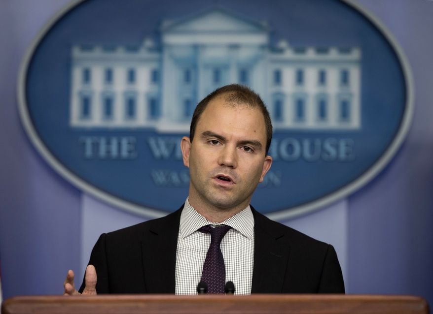 ** FILE ** Deputy National Security Adviser Ben Rhodes gestures as he speaks during the daily press briefing at the White House in Washington on Friday, June 14, 2013, in Washington. (AP Photo/Evan Vucci)