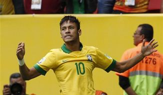 Brazil's Neymar celebrates scoring the opening goal during the opening match between Brazil and Japan in group A of the soccer Confederations Cup at the National Stadium in Brasilia, Brazil, Saturday, June 15, 2013. (AP Photo/Eugene Hoshiko)