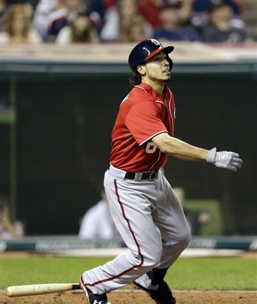 Washington Nationals' Anthony Rendon watches his ball after hitting a solo home run off Cleveland Indians relief pitcher Vinnie Pestano in the ninth inning of a baseball game, Saturday, June 15, 2013, in Cleveland. The Nationals won 7-6. (AP Photo/Tony Dejak)