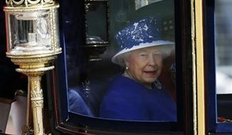 ** FILE ** Britain's Queen Elizabeth II leaves Buckingham Palace in a horse drawn carriage for the Trooping The Colour parade, at the Horse Guards Parade in London, Saturday, June 15, 2013. (AP Photo/Sang Tan)