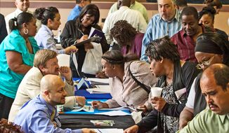 ** FILE ** Job seekers at a recent Los Angeles career fair were less likely than before the recession to find full-time work. Starting Jan. 1, larger employers must provide health care benefits to those who put in at least 30 hours a week. (Associated Press)