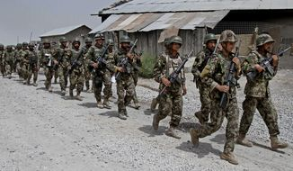 Afghan National Army soldiers march in the Sangin district of Kandahar province in southern Afghanistan on Thursday, June 13, 2013. One of the most significant turning points in one of America's longest and costliest wars is imminent: Afghanistan's fledgling security forces are taking the lead for security nationwide, bringing the moment of truth on the question of whether they are ready to fight an insurgency that remains resilient after nearly 12 years of conflict. That question is especially pressing here in this border region, where insurgents regularly ambush government forces and control parts of the countryside. (AP Photo/Allauddin Khan)
