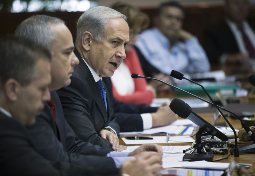 Israeli Prime Minister Benjamin Netanyahu (third from left) chairs at a weekly Cabinet meeting in Jerusalem on Sunday, June 16, 2013. Mr. Netanyahu warned the international community against easing sanctions on Iran following the election of Hasan Rowhani, a reformist-backed presidential candidate, since the country's nuclear efforts remain firmly in the hands of Iran's extremist ruling clerics. (AP Photo/Uriel Sinai, Pool)