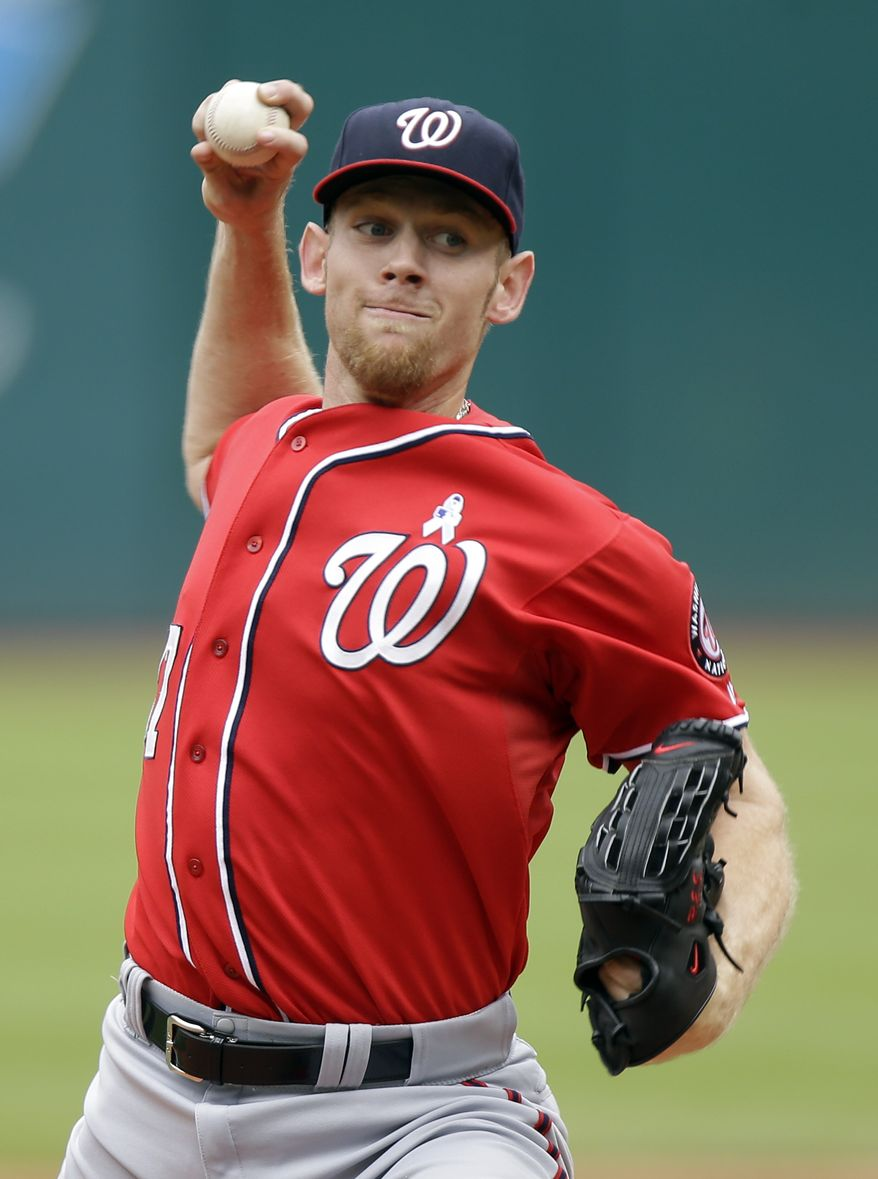 Washington Nationals starting pitcher Stephen Strasburg delivers against the Cleveland Indians in the first inning of a baseball game on Sunday, June 16, 2013, in Cleveland. (AP Photo/Mark Duncan)