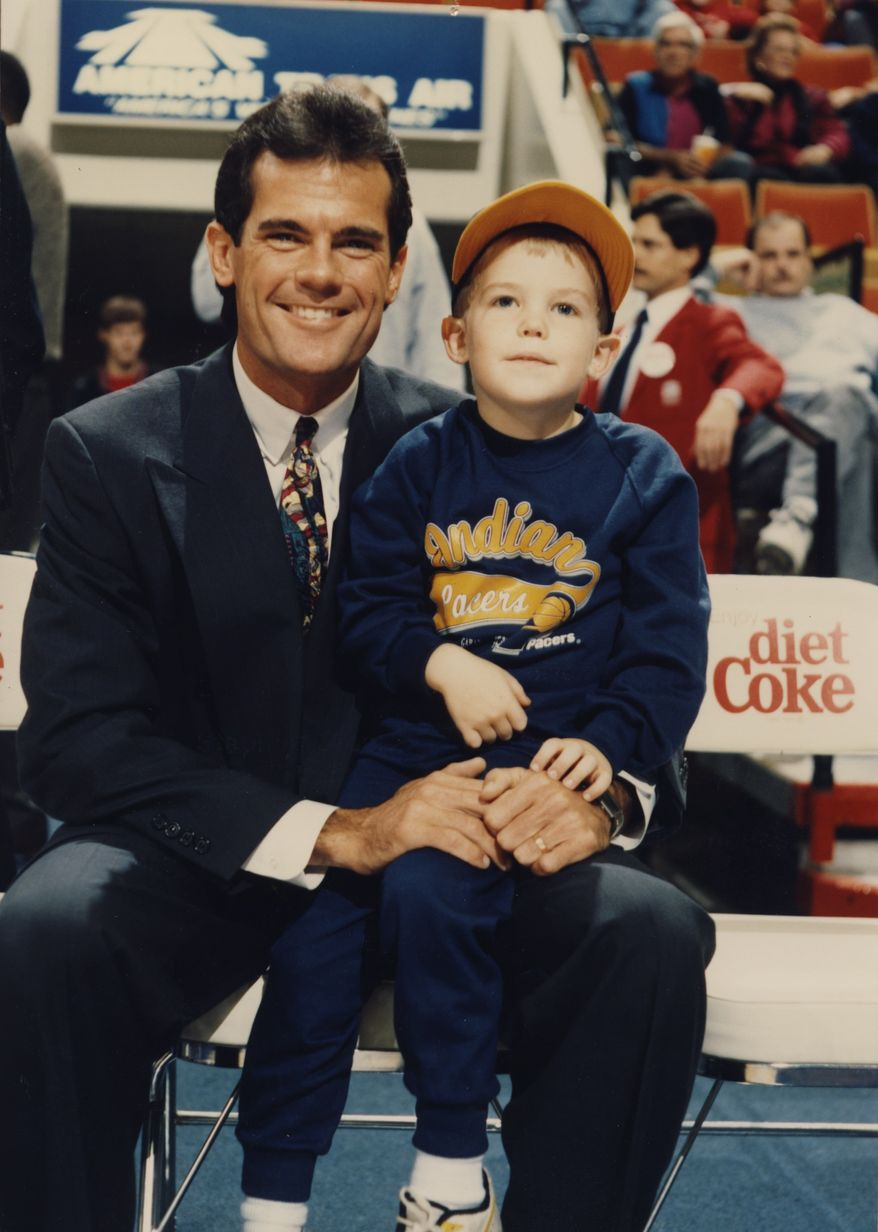 Five-year-old Drew Storen sits on the lap of his father Mark, a sportscaster.  Baseball and other sports were a major part of their lives as Drew was growing up and on his way to becoming a relief pitcher for the Nationals.