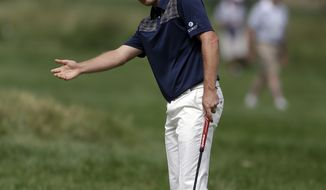 Justin Rose, of England, reacts after a putt on the second green during the fourth round of the U.S. Open golf tournament at Merion Golf Club, Sunday, June 16, 2013, in Ardmore, Pa. (AP Photo/Darron Cummings)