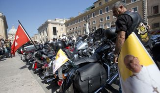 Harley-Davidson motorcycle riders park their bikes in the Via della Conciliazione leading to the Vatican (seen at left) as they wait for Pope Francis to drive by to bless them ahead of Mass in St. Peter's Square on Sunday, June 16, 2013, in Rome. The riders are gathered in the Eternal City for a four-day event to celebrate the motorcycle company's 110th anniversary. (AP Photo/Andrew Medichini)