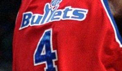 **FILE** Washington Bullets forward Chris Webber, right, goes for the stuff shot over Portland Trail Blazers center Arvydas Sabonis during NBA action in Portland, Ore., Monday, Dec. 23, 1996.(AP Photo/Don Ryan)