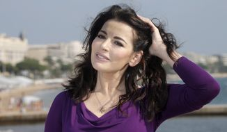 English food writer, journalist and broadcaster Nigella Lawson poses during the 28th International Film and Programme Market for TV, Video, Cable and Satellite (MIPCOM) in Cannes, France, in 2012. (AP Photo/Lionel Cironneau)