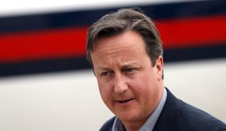 Britain's Prime Minister David Cameron arrives to attend the Enniskillen G-8 summit at the 38th Irish Brigade Flying Station Aldergrove near Belfast, Northern Ireland on Sunday, June 16, 2013. (AP Photo/Suzanne Plunkett, Pool)