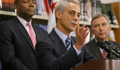 ** FILE ** Chicago Mayor Rahm Emanuel (center) is flanked by Chicago Public Schools CEO Jean-Claude Brizard (left) and school board President David Vitale during a news conference on Tuesday, Sept. 18, 2012. (AP Photo/Charles Rex Arbogast)